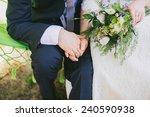 bride and groom holding hands.... | Shutterstock . vector #240590938
