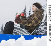 Man Relaxing In Snow