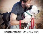 Stock photo handsome man with loving and beautiful dog paw tattoo on man s arm 240717454