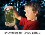 boy with a jar of fireflies | Shutterstock . vector #240718813