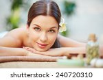 relaxed female lying in spa... | Shutterstock . vector #240720310