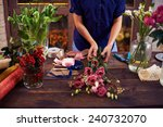 florist making rose bouquet | Shutterstock . vector #240732070