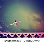 a boy jumping of an old train... | Shutterstock . vector #240820990