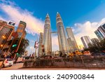 Small photo of KUALA LUMPUR, MALAYSIA - DECEMBER 20: Night time of Petronas Twin Towers on December 20, 2014 in Kuala Lumpur, Malaysia. This building (451.9m/88 floors) is the tallest twin buildings in the world