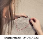 Girl Embroidering A Heart Shap...