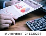 businessman analyzing... | Shutterstock . vector #241220239