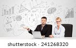 business persons at desk with... | Shutterstock . vector #241268320