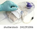 nurse adjusts flow regulator on ... | Shutterstock . vector #241291006