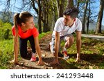 young couple jogging in park at ...   Shutterstock . vector #241293448