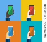 four smartphones in hands....