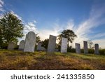Tombstones Sit Quietly In An...