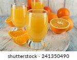 glass of orange juice with... | Shutterstock . vector #241350490