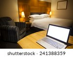 Stock photo laptop on a work desk in a luxurious hotel room 241388359