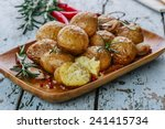 Baked Potatoes Whole In Their...