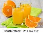 fresh orange juice on a wooden... | Shutterstock . vector #241469419
