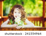 Laughing Girl With A Flower In...