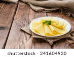 Sliced Cheese On Rustic Wooden...
