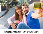 young couple taking selfie | Shutterstock . vector #241921984