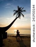 silhouette life at sunset beach. | Shutterstock . vector #241933144