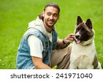Stock photo  man with his dog breed aki 241971040