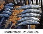 sardines on a skewer firewood...   Shutterstock . vector #242031226