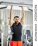 fitness man doing pull ups in a ... | Shutterstock . vector #242065246