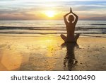 woman doing meditation near the ... | Shutterstock . vector #242100490