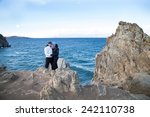 a pair of lovers on the shore... | Shutterstock . vector #242110738