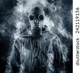 A Man In A Gas Mask Shrouded In ...
