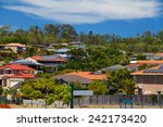 solar panels on homes in... | Shutterstock . vector #242173420
