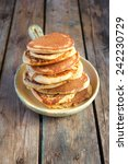 oat bran pancakes | Shutterstock . vector #242230729