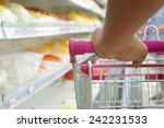 shopper with trolley at... | Shutterstock . vector #242231533