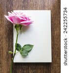 Pink Rose Flower And Book On...