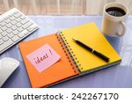 ideas word on note pad stick on ... | Shutterstock . vector #242267170