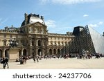 Paris, France - August 15: Entrance of Louvre Museum with lots of tourists in front, Paris France 15 August 2008 - stock photo