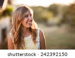attractive young blond woman... | Shutterstock . vector #242392150