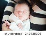 newborn in mother's hands | Shutterstock . vector #242435308