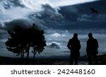 Men Standing In Dark Watching...