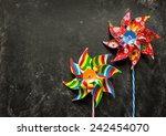 Colorful Toy Windmills On Blac...