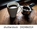 coffee cup on wooden table.    Shutterstock . vector #242486314