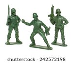 Miniature toy soldiers on white ...