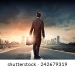 back view of businessman... | Shutterstock . vector #242679319