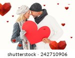 smiling couple in winter... | Shutterstock . vector #242710906