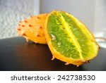 Small photo of Kiwano fruit, also known as horned melon, African horned cucumber, jelly melon or melano, cut in half.