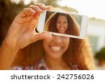 Woman On Holiday Taking Selfie...