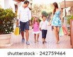 Family Walking Along Street...