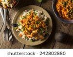 homemade chicken tikka masala... | Shutterstock . vector #242802880