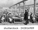 Seamstresses at long tables in the sewing-room at A.T. Stewart