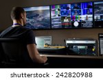 tv engineer at editor in studio.... | Shutterstock . vector #242820988