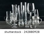 different glassware on dark... | Shutterstock . vector #242880928